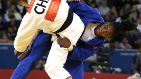Edwige Gwend of Italy, right, throws Lili Xu of China during the women's 63-kg judo competition at the 2012 Summer Olympics, Tuesday, July 31, 2012, in London. (AP Photo/Paul Sancya)