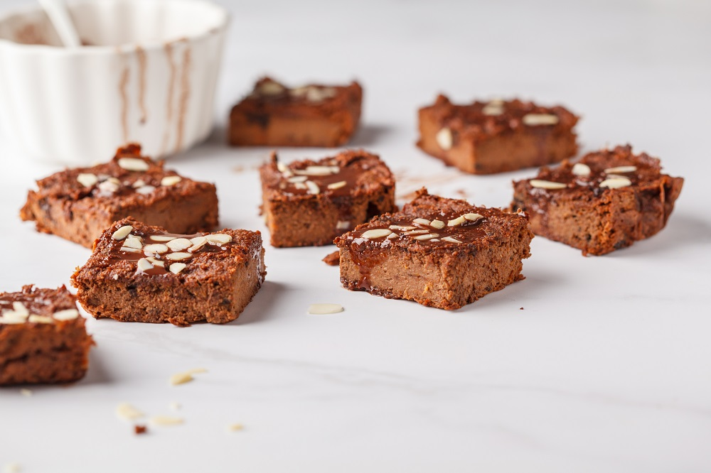 Vegan Sweet Potato Brownie On White Table. Healthy Vegan Food Concept.