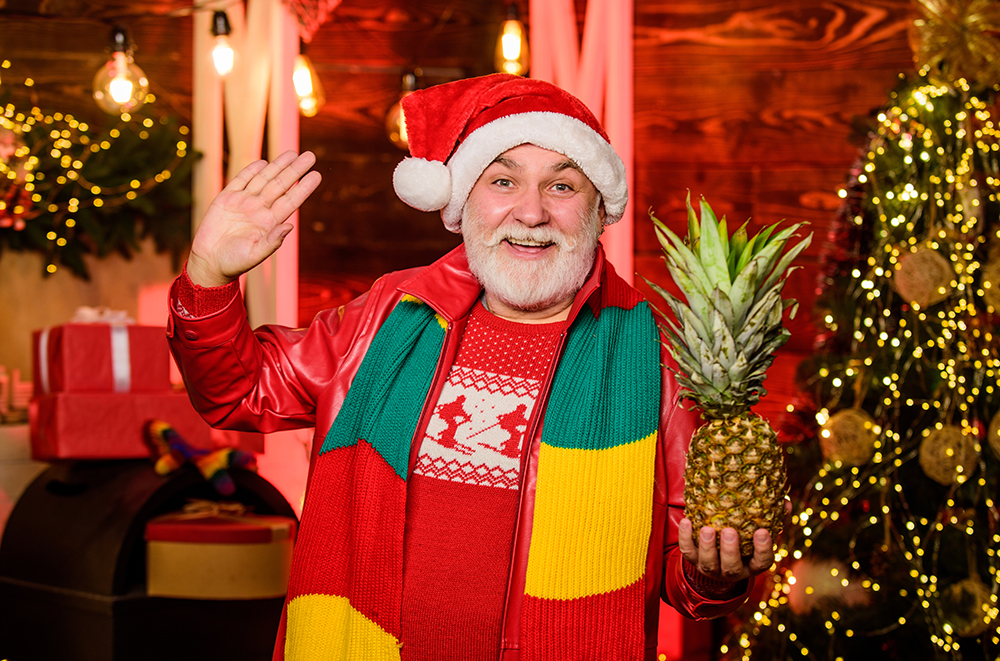 healthy gift. bearded man healthy eating. merry christmas. happy new 2020 year. xmas gifts and presents. winter season. holiday with vitanin. cheerful santa man hold pineapple. exotic fruit for feast